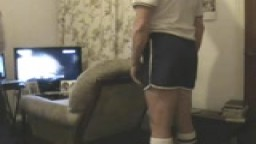 Caned in gym shorts