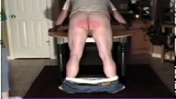 Bent over the table being paddled