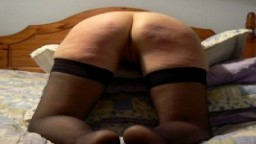 A caning - she was well warmed first...