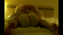 STRAPPED OVER TEDDY ON THE BED