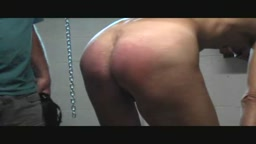 Kneeling flogged and strapped