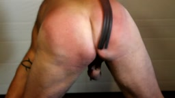 Punishing the arse - rubber prison straps and tawses