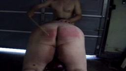 Caned and Spanked in the Garage