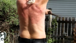 self flagellation outdoors using a leather pet leash