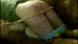 CANED ON THE COUCH