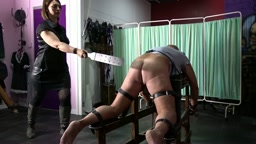 Mistress Raven Administers the Prison Strap