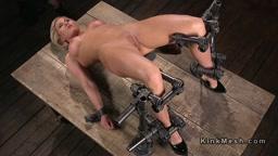 Gagged blonde flogged in bondage