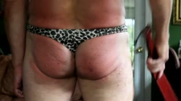 in the style of Sir Alex - thong with leopard pattern