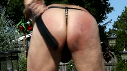 outdoor self discipline with a black smooth edge bullhide belt on a leather thong with codpiece